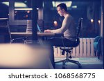 young man working on laptop at... | Shutterstock . vector #1068568775