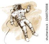 cosmonaut or astronaut in... | Shutterstock .eps vector #1068570008