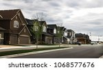 new street in residential... | Shutterstock . vector #1068577676