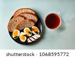 healthy breakfast. boiled eggs  ... | Shutterstock . vector #1068595772