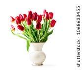 red tulip flowers in vintage...   Shutterstock . vector #1068633455
