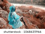a lonely girl in a raincoat... | Shutterstock . vector #1068635966