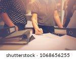 an office worker is working in ... | Shutterstock . vector #1068656255