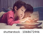 two chinese children addicted... | Shutterstock . vector #1068672446