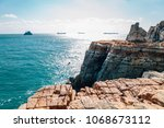 taejongdae cliff and sea in... | Shutterstock . vector #1068673112