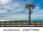 landscape with palm tree and a... | Shutterstock . vector #1068779882