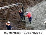 top view of builders in red...   Shutterstock . vector #1068782966