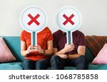 couple showing wrong symbol sign | Shutterstock . vector #1068785858