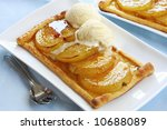 Nashi pears on puff pastry, with a lemon and ginger glaze, topped with rich vanilla ice cream.  Delicious! - stock photo