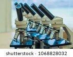 school microscopes for students ... | Shutterstock . vector #1068828032