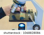 students experimenting and... | Shutterstock . vector #1068828086