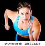 Young female athlete running - isolated over a black background - stock photo