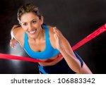 Winner female athlete crossing the finishing line - stock photo