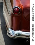 Small photo of Reflections in chrome details of of exterior of a classic car in SoCo, Austin