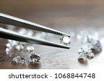 brilliant cut diamond held by... | Shutterstock . vector #1068844748