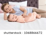 cute little baby with elder... | Shutterstock . vector #1068866672