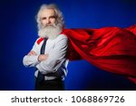 the superhero. a man with a red ... | Shutterstock . vector #1068869726