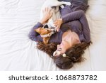 top view of a beautiful young... | Shutterstock . vector #1068873782