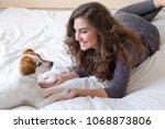 beautiful young woman lying on... | Shutterstock . vector #1068873806
