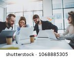 project team working together... | Shutterstock . vector #1068885305
