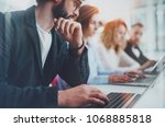 closeup view of young coworkers ... | Shutterstock . vector #1068885818