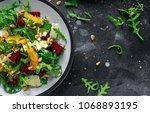 fresh beet  orange salad with... | Shutterstock . vector #1068893195