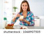 beautiful young woman preparing ... | Shutterstock . vector #1068907505