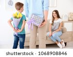 husband and son hiding flowers... | Shutterstock . vector #1068908846