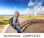 young beautiful female tourist... | Shutterstock . vector #1068915212