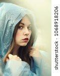 girl in raincoat. portrait of... | Shutterstock . vector #1068918206