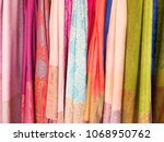 colorful scarves at a market in ... | Shutterstock . vector #1068950762