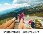 legs of traveler couple | Shutterstock . vector #1068969275