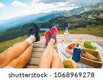 legs of traveler couple | Shutterstock . vector #1068969278