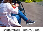 a woman sit on the floor... | Shutterstock . vector #1068973136
