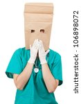 ashamed doctor with paper bag on his head, white background - stock photo
