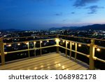 wood balcony decorated with... | Shutterstock . vector #1068982178