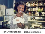 young african entrepreneur in... | Shutterstock . vector #1068985388