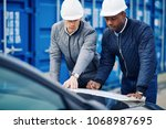 two engineers standing by... | Shutterstock . vector #1068987695