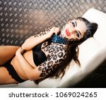 young sexy woman with leopard... | Shutterstock . vector #1069024265