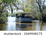 louisiana swamp tours | Shutterstock . vector #1069048175