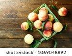 ripe peaches in a decorative... | Shutterstock . vector #1069048892