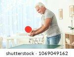Senior Man Playing Table Tenni...