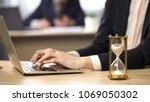 female working on laptop at... | Shutterstock . vector #1069050302