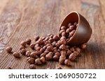 hazelnuts in overturned ceramic ... | Shutterstock . vector #1069050722
