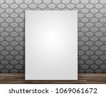 blank canvas leaning against a... | Shutterstock . vector #1069061672