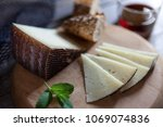 cured cheese on board | Shutterstock . vector #1069074836