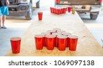 game beer pong on wooden table | Shutterstock . vector #1069097138