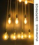 vintage electric bulb. | Shutterstock . vector #1069098428