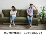 husband and wife sitting on... | Shutterstock . vector #1069103795