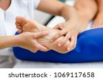 medical massage at the foot in... | Shutterstock . vector #1069117658